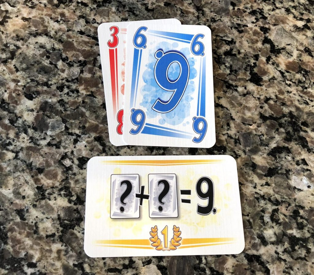 Mission card - two cards of either color which add up to nine.