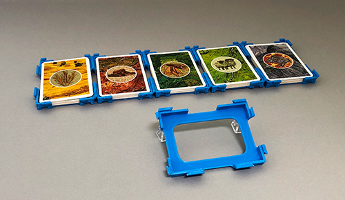 The connectable series of Catan card holders.
